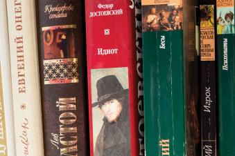 A shelf with books of the great Russian writers of the classics: Pushkin, Lermontov, L. Tolstoy, F. Dostoevsky, A. Chekhov