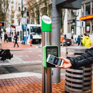 Close-up of someone scanning their transit hop card at a TriMet station