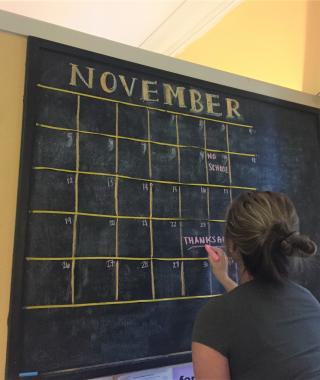 Chalkboard with a calendar of events.