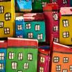 An arrangement of boxes, painted to look like buildings and arranged to look like a city.