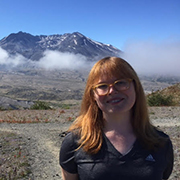 amanda standing with mt st helens in the background