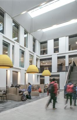 students walking through building atrium