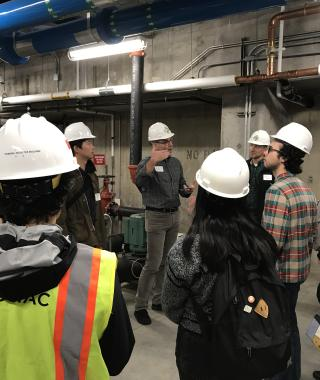 students in hard hats in mechanical room of student rec center