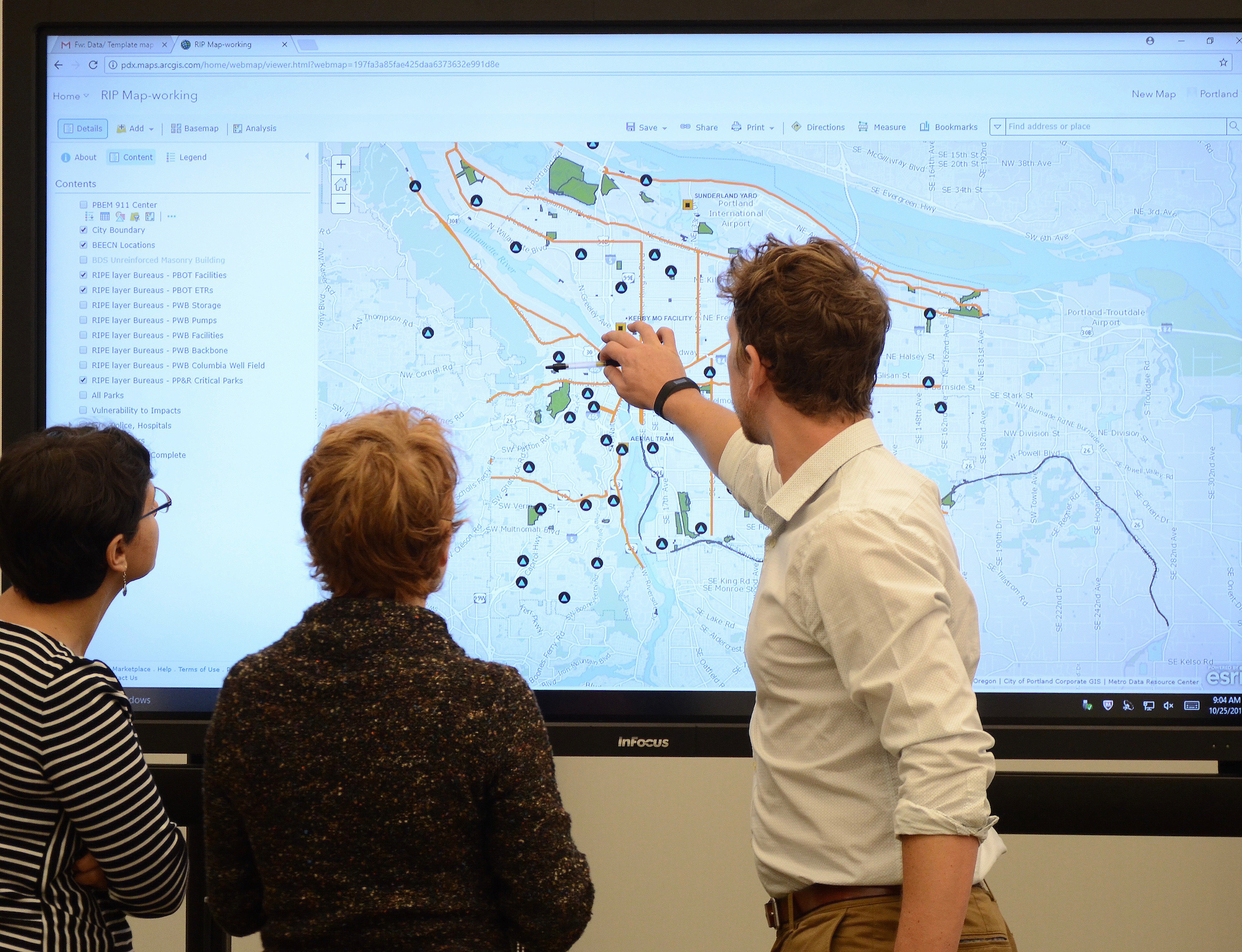 People interacting with a digital map