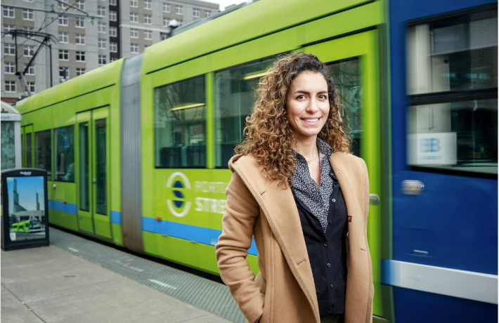 Student in front of Portland Streetcar