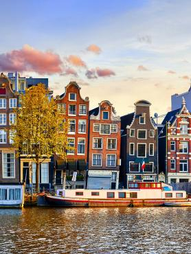 Amsterdam Netherlands dancing houses over river Amstel landmark in old European city spring landscape.