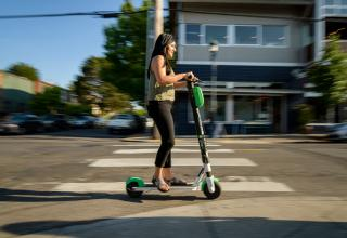 Woman riding on an electric scooter