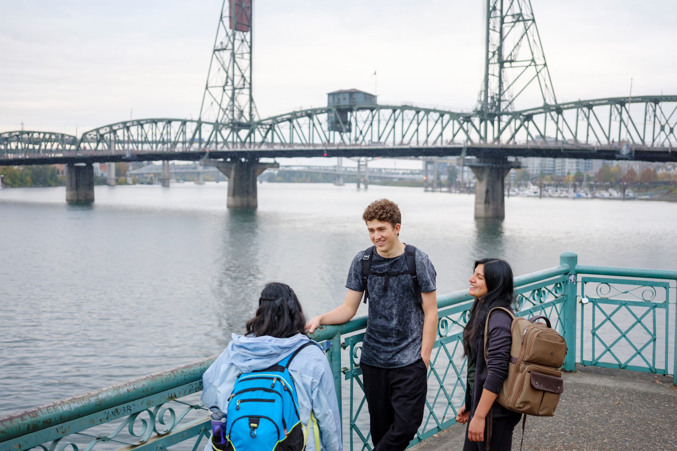 Students standing near Hawthorne Bridge