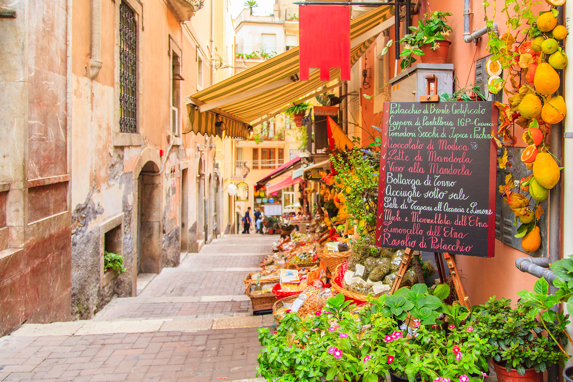 Side street in Italian city a with a vegetable/fruit market